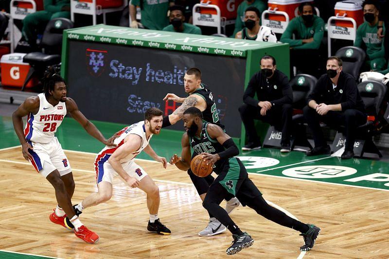 Svi Mykhailiuk #19 of the Detroit Pistons defends Jaylen Brown #7 of the Boston Celtics