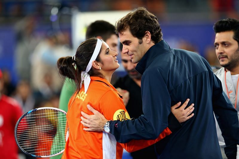 Sania Mirza (L) and Roger Federer