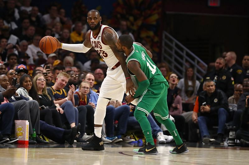 LeBron James #23 of the Cleveland Cavaliers looks to get around Kyrie Irving #11 of the Boston Celtics in 2017. Cleveland won the game 102-99. (Photo by Gregory Shamus/Getty Images)