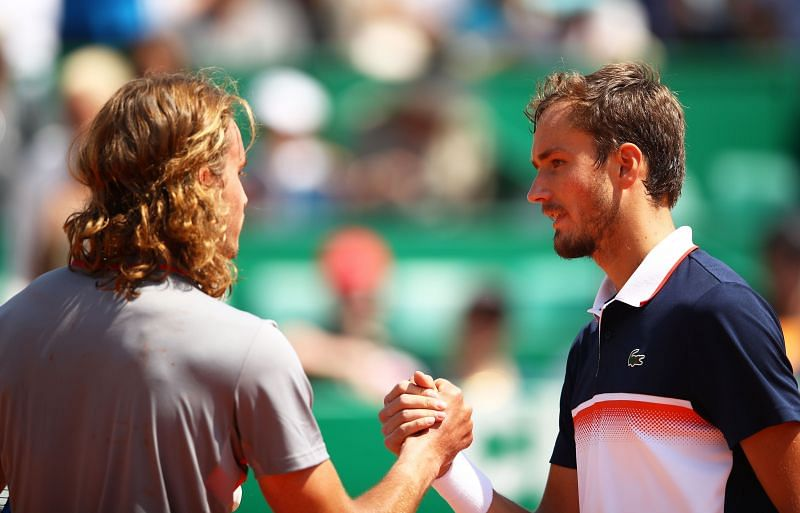 Daniil Medvedev (R) and Stefanos Tsitsipas shake hands at the 2019 Monte Carlo Rolex Masters