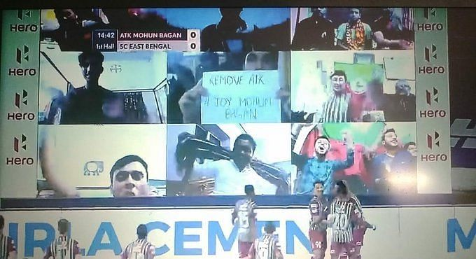 A Mohun Bagan fan displays a poster to remove the ATK prefix in ISL
