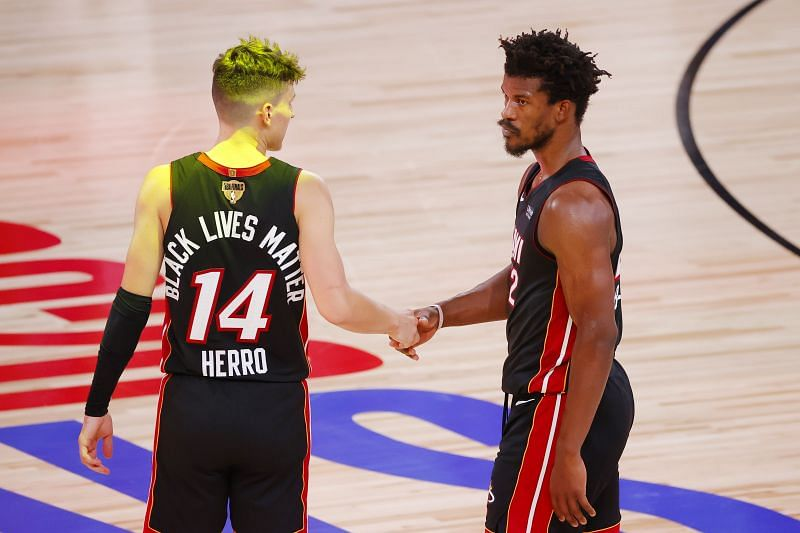 Tyler Herro #14 of the Miami Heat reacts with Jimmy Butler #22 after defeating the LA Lakers in Game Three of the 2020 NBA Finals