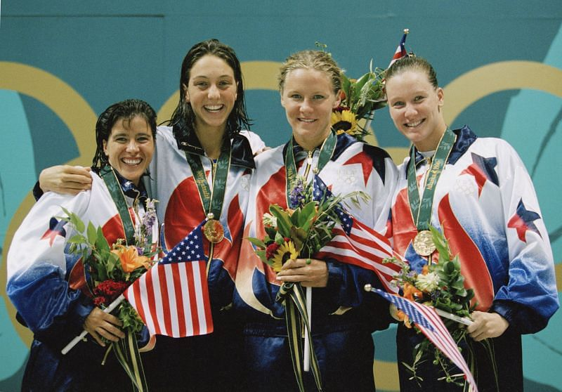 Sheila Taormina, Christina Teuscher, Jenny Thompson and Trina Jackson of the United States celebrate winning the gold medal in the Women