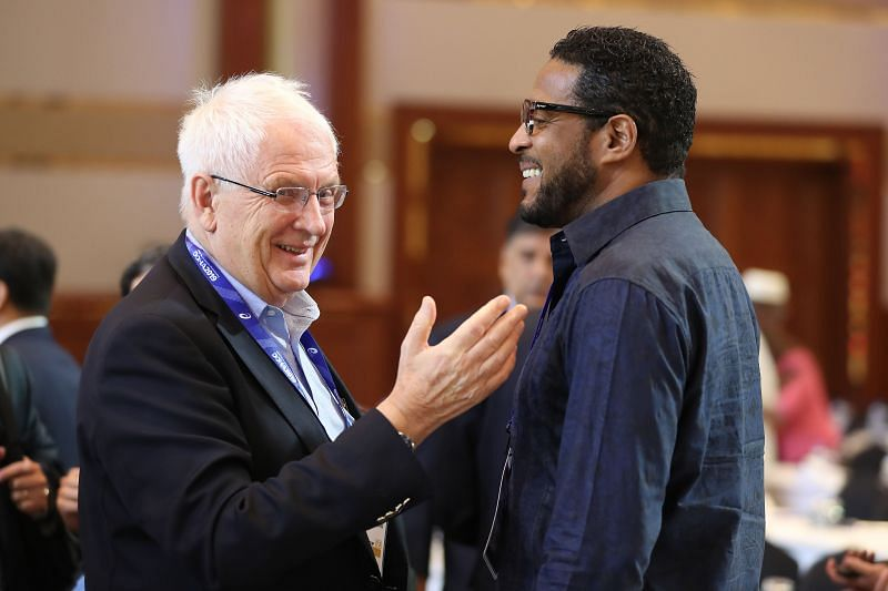 Svein Arne Hansen talks to Javier Sotomayor (R) during the 52nd IAAF Congress in September 2019 in Doha, Qatar