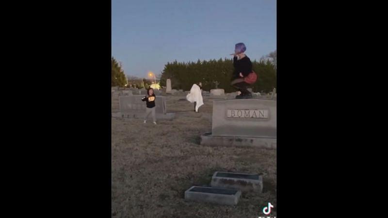 Mom and two kids dancing in the graveyard (Image Via YouTube/Pegasus)