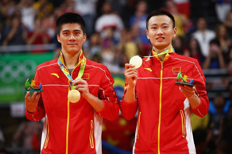 Gold medalists Haifeng Fu and Nan Zhang of China stand on the podium during the medal ceremony after the Men