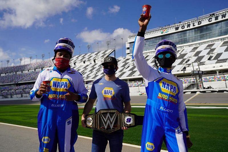 The Street Profits presenting the WWE Championship to NASCAR driver, Chase Elliott.