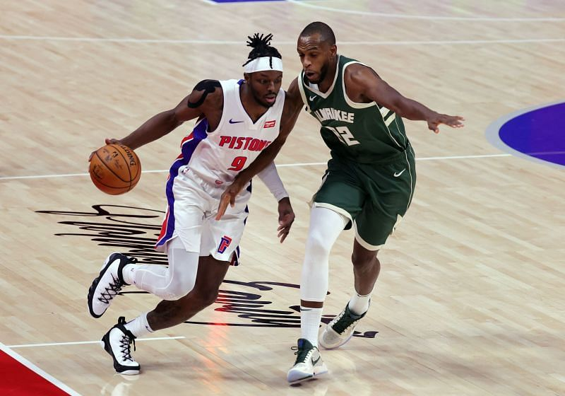 Jerami Grant of the Detroit Pistons drives against Khris Middleton of the Milwaukee Bucks Photo by Leon Halip/Getty Images)