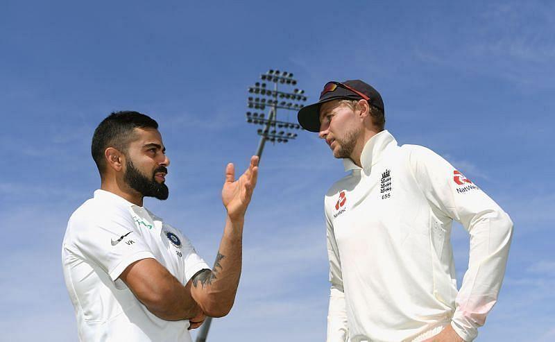Virat Kohli and Joe Root in discussion