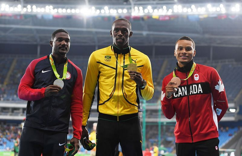 Bolt (centre), Gatlin (left) and De Grasse (right)  pose with their medals after 100m race at 201Rio Olympics