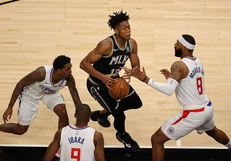 Marcus Morris and Lou Williams of the LA Clippers in action against the Atlanta Hawks