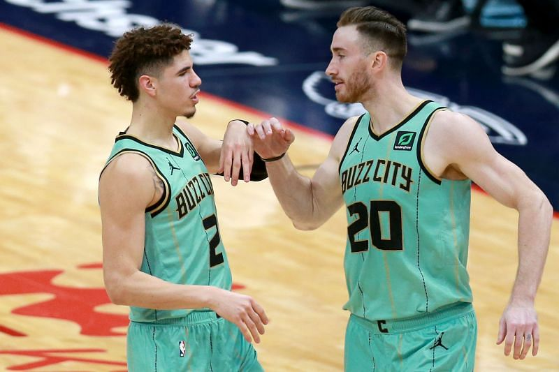 LaMelo Ball #2 and Gordon Hayward #20 of the Charlotte Hornets react in a game against the New Orleans Pelicans