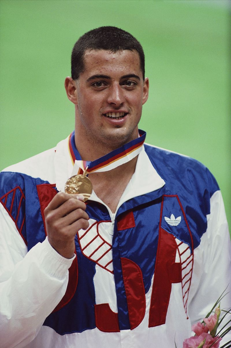 Matt Biondi of the United States celebrates with his Gold medal after winning the Men