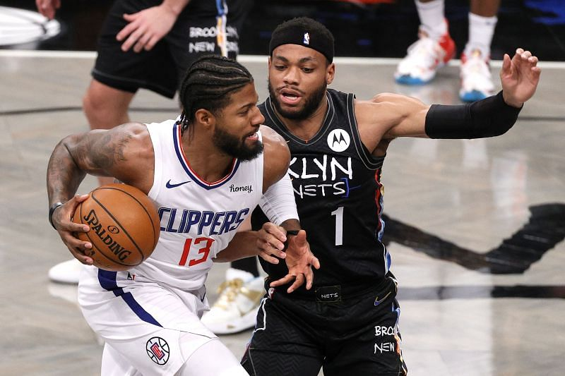 Paul George #13 of the LA Clippers drives toward the basket as Bruce Brown #1 of the Brooklyn Nets defends