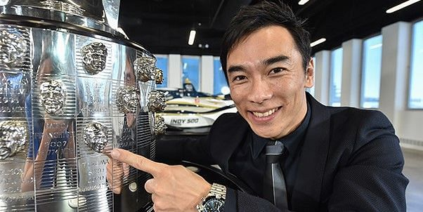 Takuma Sato points to his likeness on the Borg-Warner Trophy in a reveal on Friday. Photo provided Indianapolis Motor Speedway