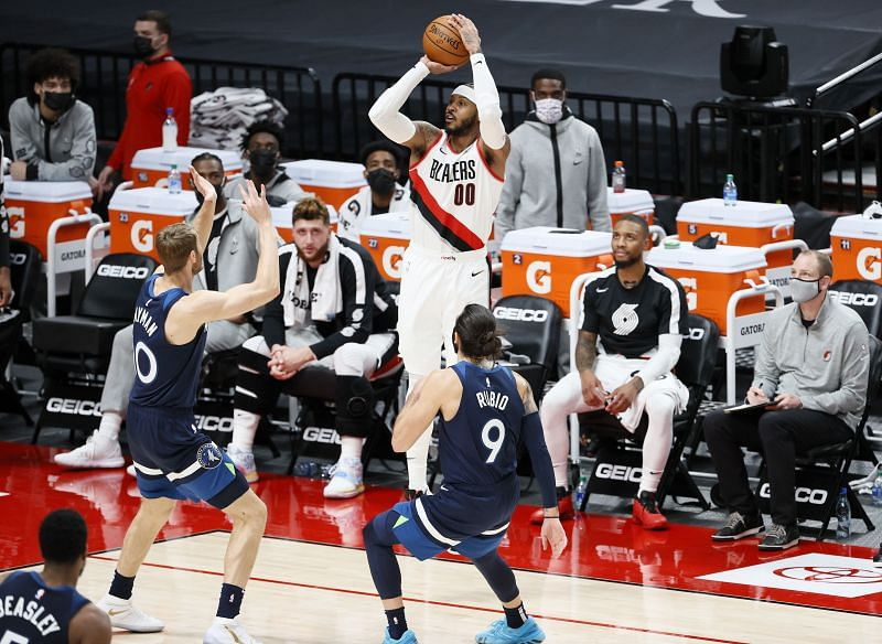 Carmelo Anthony #00 of the Portland Trail Blazers shoots a three against the Minnesota Timberwolves