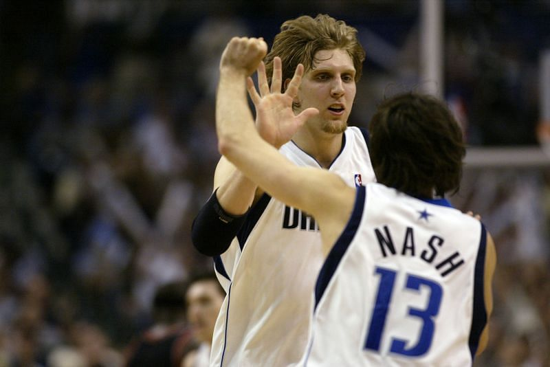 Dirk Nowitzki celebrates with Steve Nash.