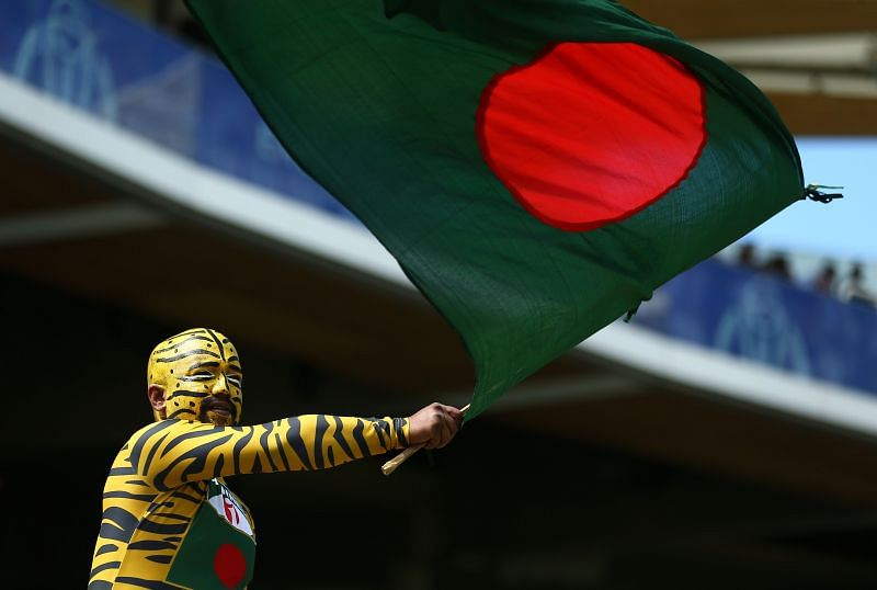 A Bangladesh cricket fan waves the national flag