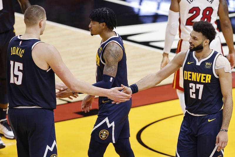 Nikola Jokic #15 and Jamal Murray #27 of the Denver Nuggets celebrate against the Miami Heat during the fourth quarter at American Airlines Arena (Photo by Michael Reaves/Getty Images)