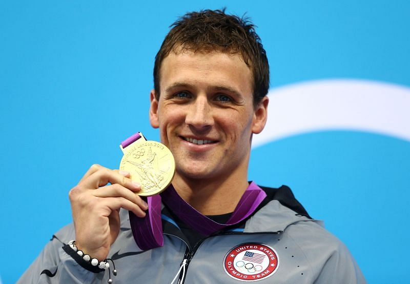 : Ryan Lochte of the United States celebrates with his Gold Medal during the Medal Ceremony for the Men