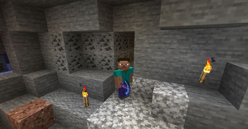 Steve with an enchanted diamond pickaxe in Minecraft (Image via Minecraft)