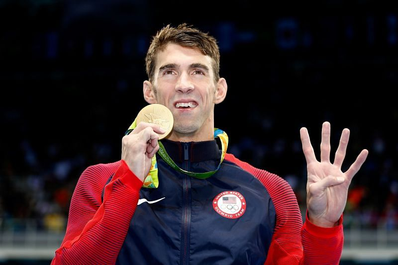 Gold medalist Michael Phelps of the United States celebrates during the medal ceremony for the Men