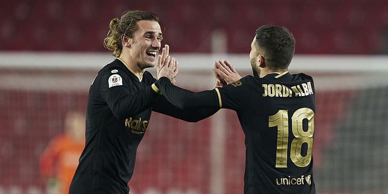 Antoine Griezmann celebrates with Jordi Alba in Barcelona's 5-3 win over Granada