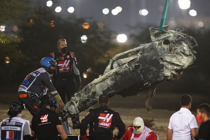 Track marshals clear the debris following Romain Grosjean