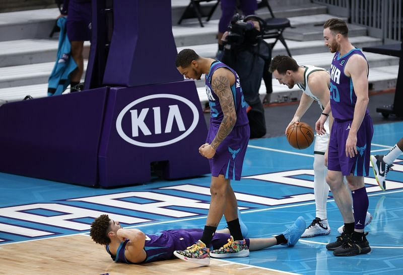 LaMelo Ball #2 of the Charlotte Hornets reacts with teammate P.J. Washington