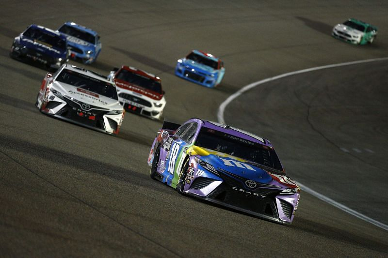 Kyle Busch leads the field in the NASCAR Cup Series Dixie Vodka 400 at Homestead. Photo/Getty Images