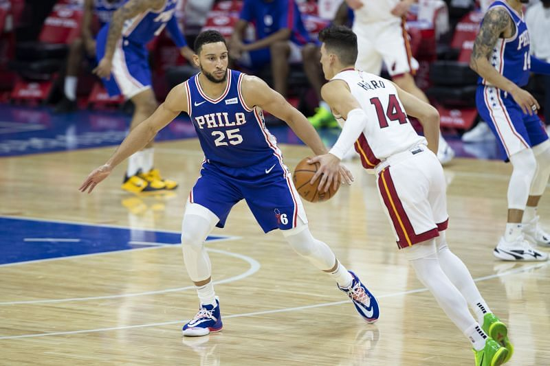 Ben Simmons #25 of the Philadelphia 76ers guards Tyler Herro #14 of the Miami Heat.