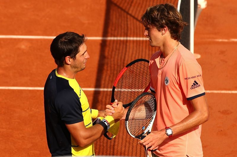 Dusan Lajovic and Alexander Zverev after their match at the 2018 French Open