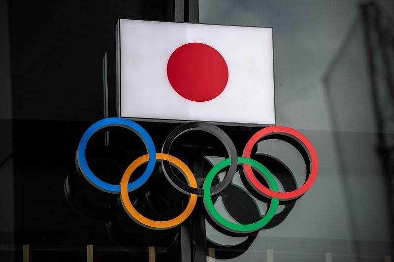 : The Japanese flag is displayed over the Olympic Rings on October 13, 2020 in Tokyo, Japan.