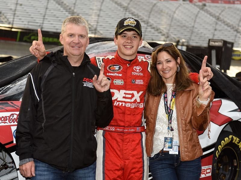 Harrison Burton with his father, Jeff, and mother, Kim. Photo/Getty Images