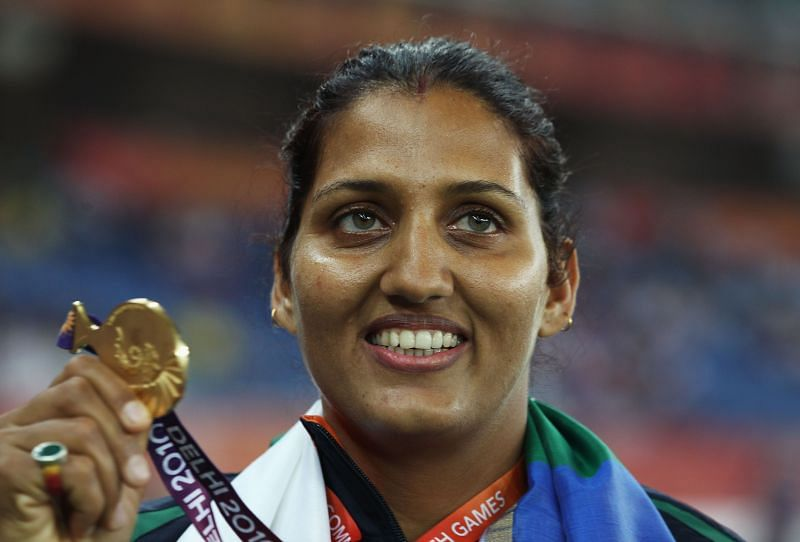 Krishna Poonia with her Commonwealth Games gold medal