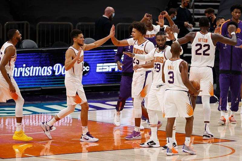 Devin Booker of the Phoenix Suns celebrates with Mikal Bridges, Jae Crowder, Deandre Ayton and Chris Paul after defeating the Dallas Mavericks in an NBA game (Photo by Christian Petersen/Getty Images)