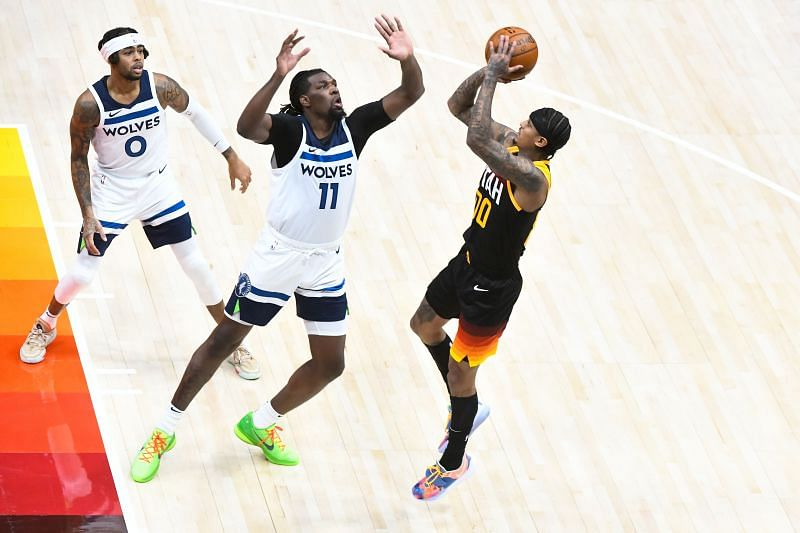 Jordan Clarkson #00 of the Utah Jazz shoots over Naz Reid #11 of the Minnesota Timberwolves during a game at Vivint Smart Home Arena on December 26, 2020 in Salt Lake City, Utah.