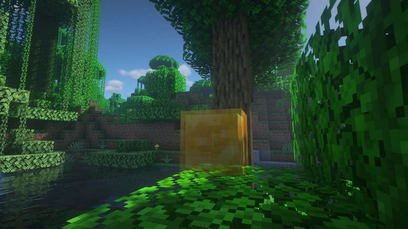 Honey blocks  in Minecraft can be crafted with the help of four honey bottles (Image via Minecraft)