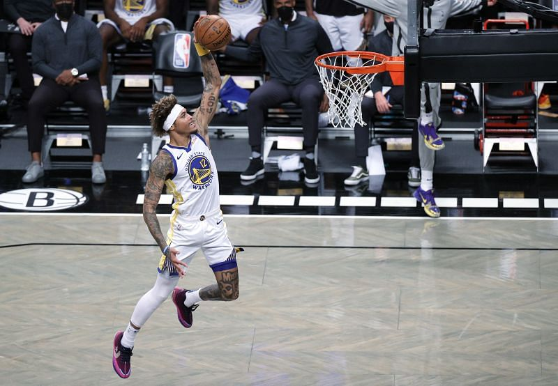Kelly Oubre Jr #12 of the Golden State Warriors dunks