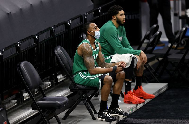 Jeff Teague #55 and Jayson Tatum #0 of the Boston Celtics sit in the cool down area