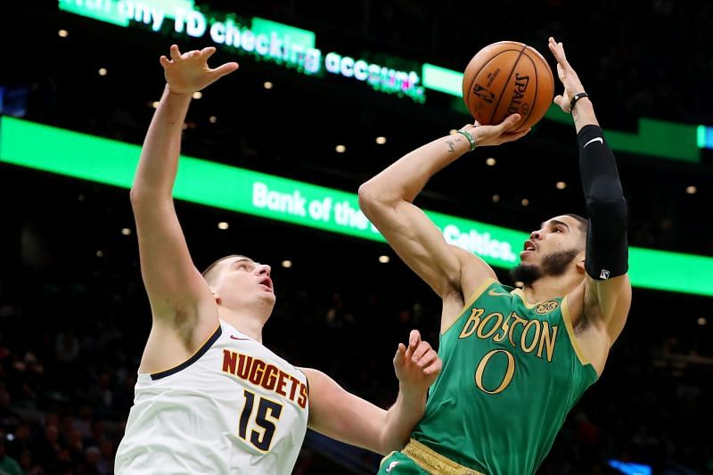 Jayson Tatum of the Boston Celtics takes a shot over Nikola Jokic of the Denver Nuggets during the second half at TD Garden on December 06, 2019, in Boston, Massachusetts. (Photo by Maddie Meyer/Getty Images)
