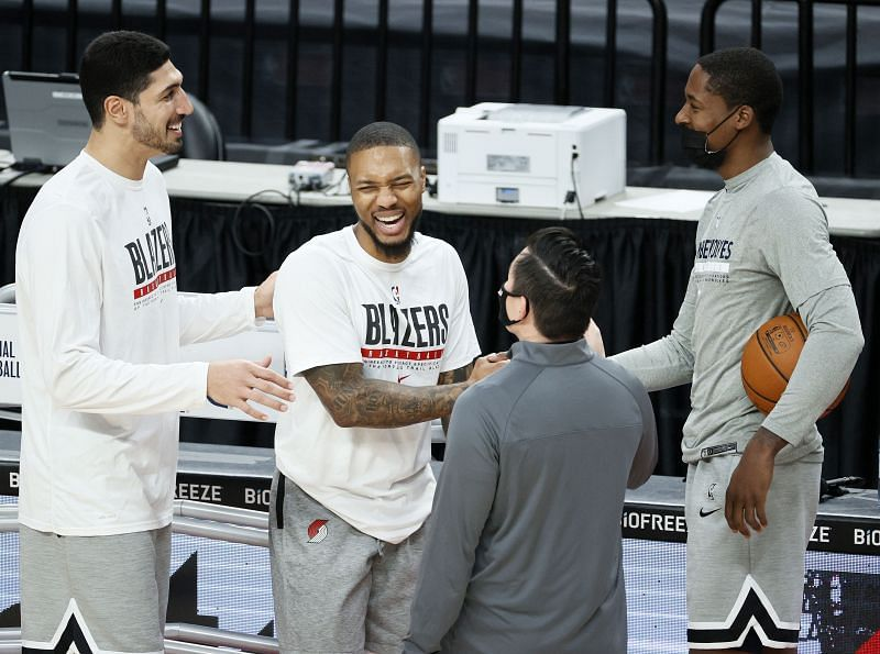 Enes Kanter #11 and Damian Lillard #0 of the Portland Trail Blazers greet Minnesota Timberwolves staff before the game at Moda Center on January 07, 2021 (Photo by Steph Chambers/Getty Images)