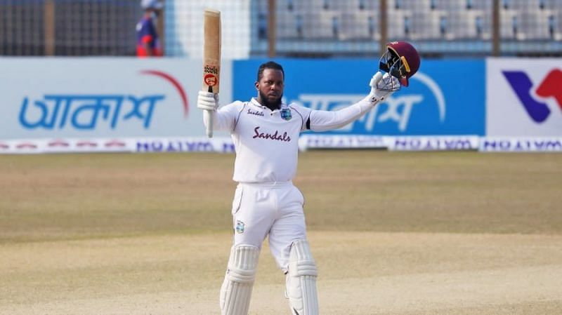 Kyle Mayers celebrating after reaching his century