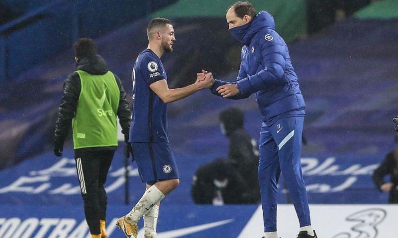 Mateo Kovacic celebrates with Thomas Tuchel following Chelsea