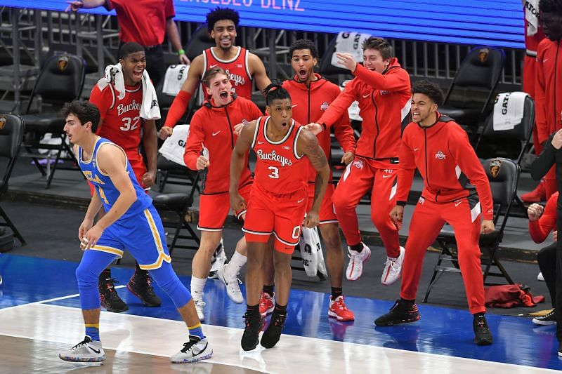 Ohio State bench celebrating a shot made by #3 Eugene Brown