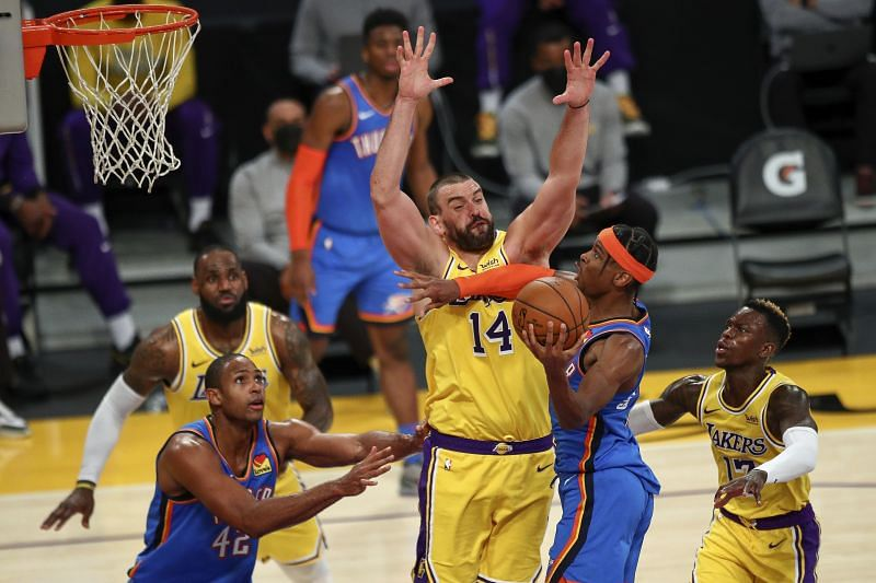 Marc Gasol #14 of the Los Angeles Lakers defends against Shai Gilgeous-Alexander #2 of the Oklahoma City Thunder.