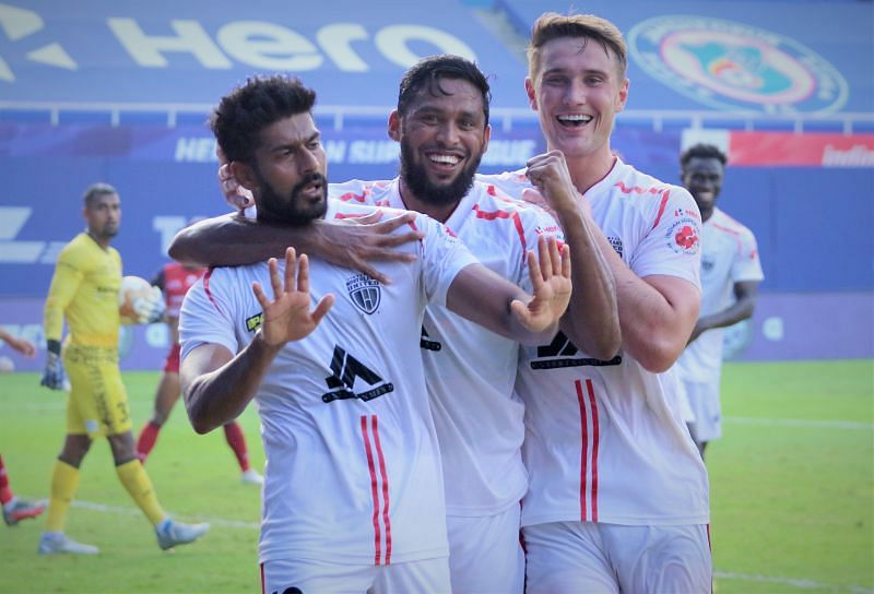 NEUFC players are pumped up after netting in a goal (Image Courtesy: ISL Media)
