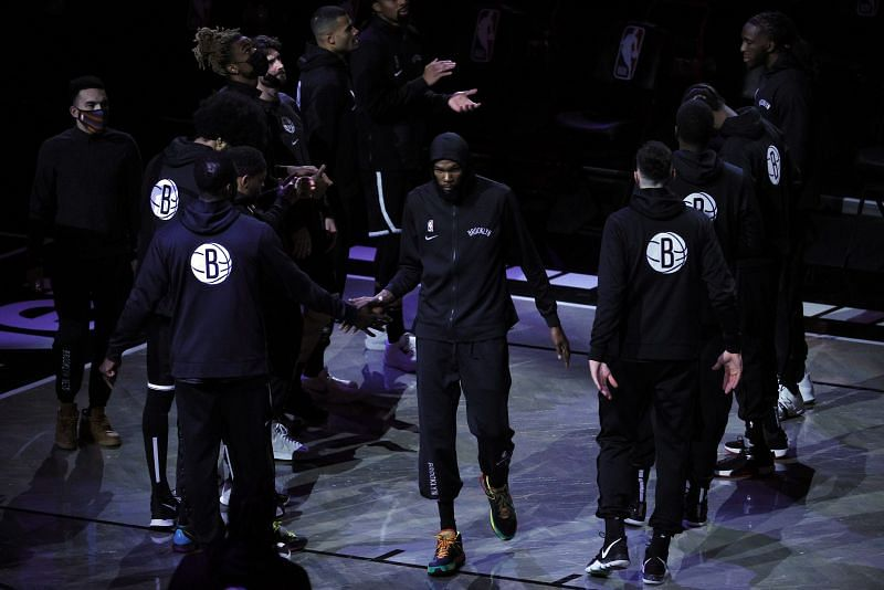 Kevin Durant of the Brooklyn Nets high-fives teammates before the first half against the Golden State Warriors at Barclays Center on December 22, 2020