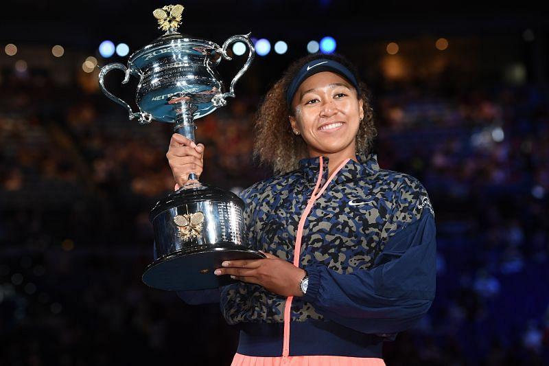 Naomi Osaka holding aloft the 2021 Australian Open trophy