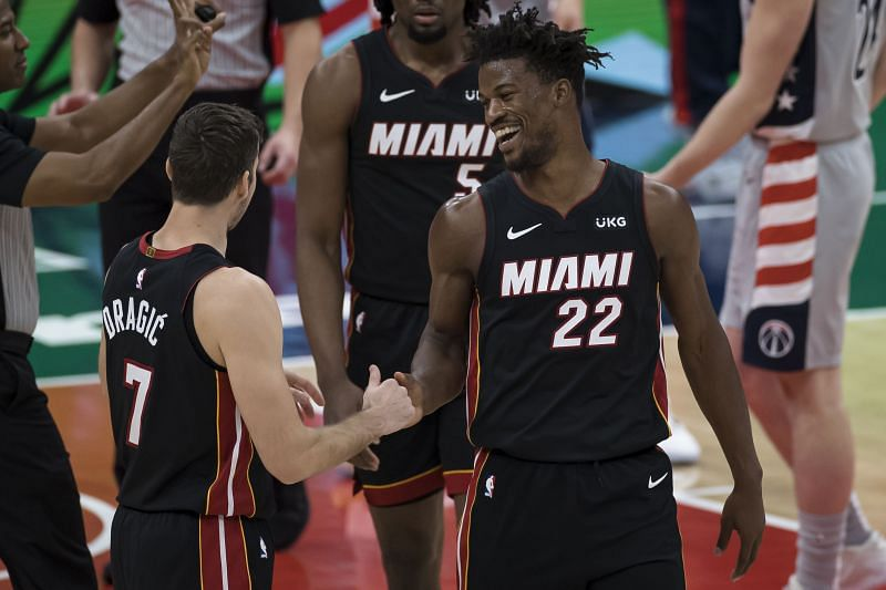 Jimmy Butler of the Miami Heat celebrates with Goran Dragic after a play against the Washington Wizards (Photo by Scott Taetsch/Getty Images)